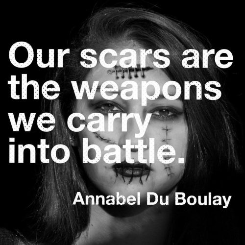 Image with text: Our scars are the weapons we carry into battle