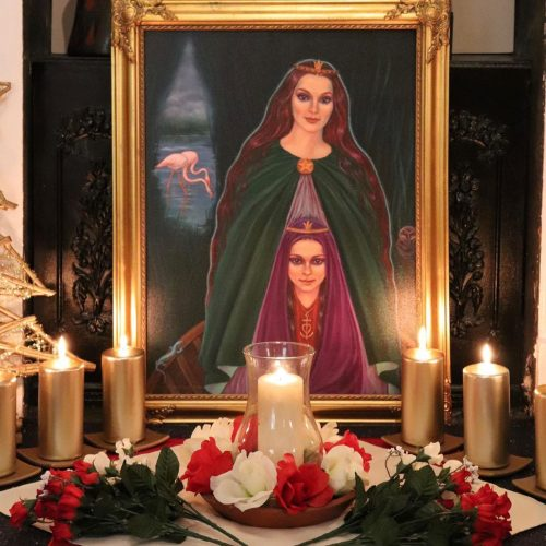 Image of Mary Magdalene surrounded by candles